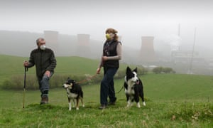 Walkers wearing smog masks near Ironbridge power station as the pollution moved westwards