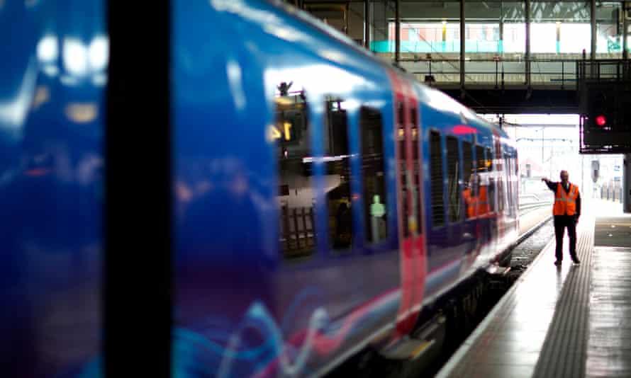 A TransPennine Express service prepares to depart Leeds station for Manchester