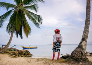 A young Kuna woman looks out across the Caribbean sea