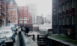 Views of the Rochdale Canal including a building at the entrance to a car park and the disused canal and locksDateMay 1974
