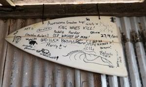 Graffiti on a broken surfboard.