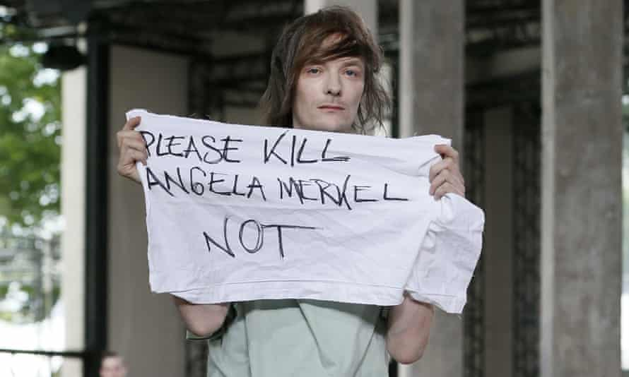 A model known as Jera protests during the Rick Owens show on Thursday.