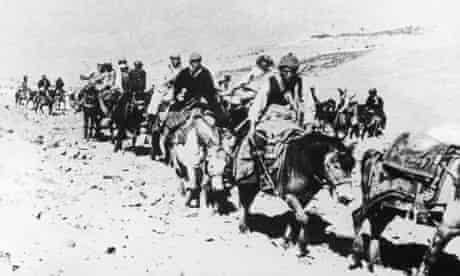 The 14th Dalai Lama flees from Tibet to India across the Himalayas, following a failed uprising against the Chinese occupation, 1959. He is riding a white pony, third from the right.