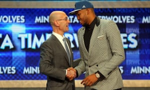 NBA commissioner Adam Silver shakes hands with Kentucky's Karl-Anthony Towns who the Minnesota Timberwolves made the top pick in the 2015 NBA Draft.
