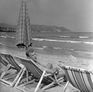 John Charles, then a Juventus player, sits in a deckchair as he relaxes during a holiday in Diano Marina, Italy, in 1958