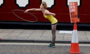 A anti-fracking protester plays with a hula hoop during a demonstration outside County Hall in Preston.
