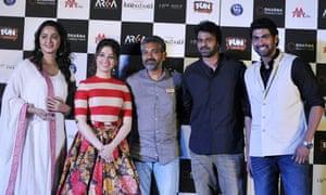 Anushka Shetty, Tamannaah Bhatia, Prabhas  and Rana Daggubati pose with writer and director SS Rajamouli (centre) at the trailer launch for Baahubali