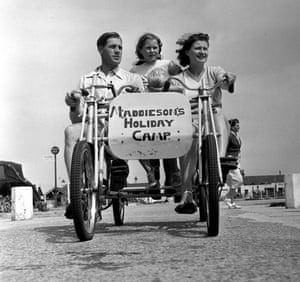 The Tottenham Hotspur goalkeeper Ted Ditchburn takes a tour round a Maddieson's holiday camp with his wife, Joan, and children Robin and Christine in 1952