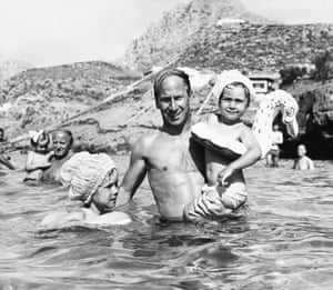 Manchester United's Bobby Charlton in the sea with his daughters Suzanne and Andrea in 1968