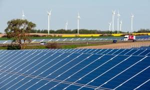 Rape field, solar modules, wind turbines.