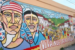 A mural of depicting Miami's Hispanic community, emblazoned with the words: 'Long live our race!'