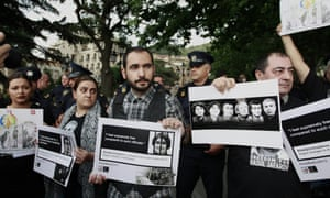 Demonstrators protesting against Azerbaijan human rights abuses in Tbilisi, Georgia, part of rallies organised in cities around the world ahead of the opening ceremony.
