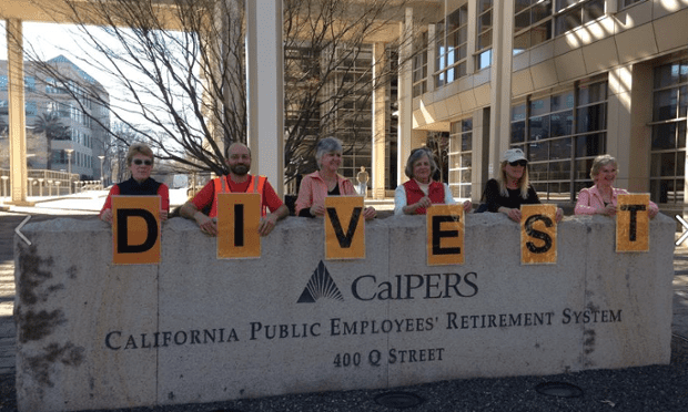 Fossil Free California activists during a rally at CalSTRS on June 12, 2015