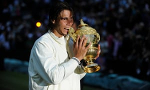 Wimbledon 2008: Rafael Nadal with the Wimbledon men's singles trophy after defeating Roger Federer in an epic match
