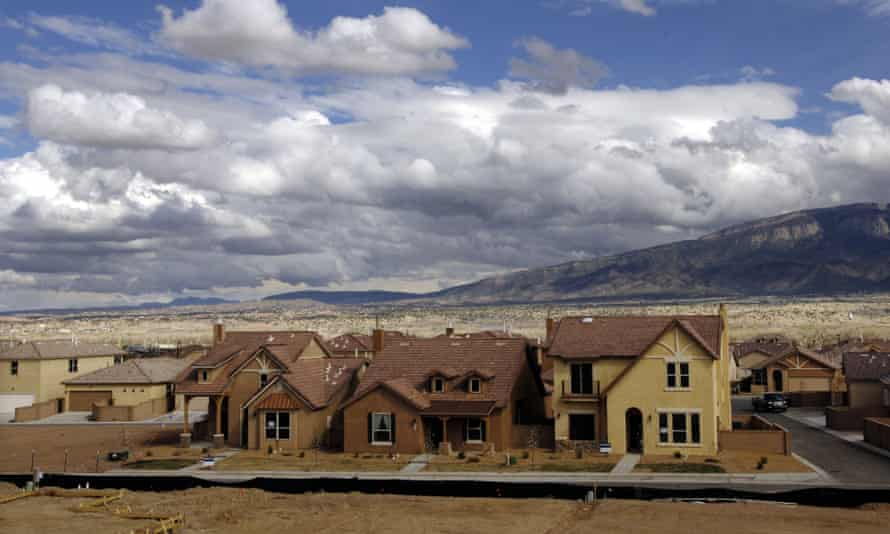 New housing developments are spreading through the desert basin west of Albuquerque, New Mexico. City planners in desert regions are on the front lines of rethinking how growing populations should maximize limited water resources.