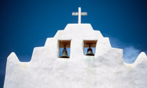 Bells and a cross on top of Mission San Jose de Laguna Church, New Mexico.