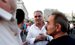 Labour minister Panos Skourletis, pictured here at a demonstration earlier this month, says nothing has been agreed to by Athens.