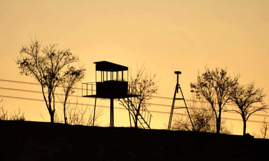 An empty Turkish border post next to the barbed-wire-fence border with Syria.