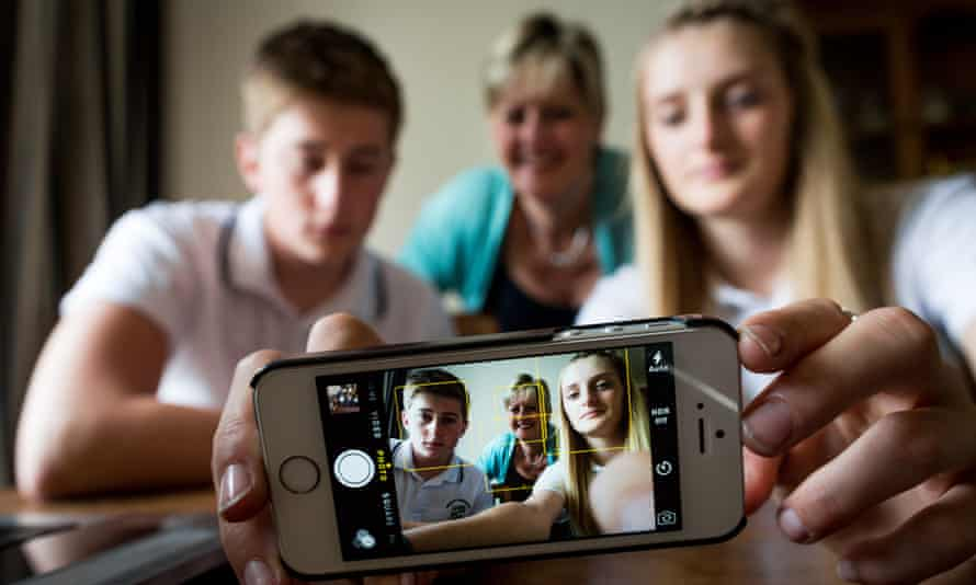 Debbie Bird and her children James, 15, and Charlotte, 13, who are all unplugging their electronic gadgets this weekend for National Unplugging Day.