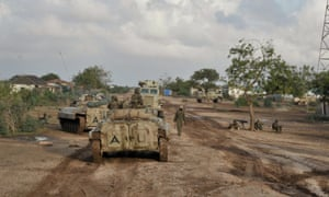 Troops from the African Union Mission in Somalia (Amisom) on patrol in Kurtunwaarey.