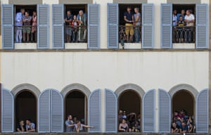 Fans watch the brutal action from houses surrounding the Santa Croce square.