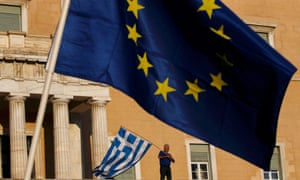 EU and Greek flags are waved in Athens.