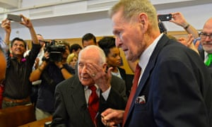 Eighty-two-year-old George Harris and 85-year-old Jack Evans kiss after getting married at court house after fifty four years together in Dallas,