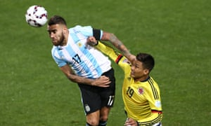 Nicolás Otamendi of Argentina goes for a header with Colombia's Teófilo Gutiérrez Copa América quarter-final.