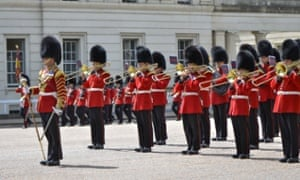 Grenadier Guards undergo drill and music rehearsal in London ahead of Armed Forces Day on Saturday.
