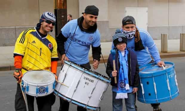 Fans with their shirts and drums