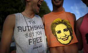 """A man wears a shirt saying """"The Ruth Shall Set You Free,"""" a reference to U.S. Supreme Court Justice Ruth Bader Ginsburg, as he stands next to a man with a Hillary Clinton shirt at a celebration rally in West Hollywood, California"""
