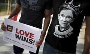 """A man wears a T-shirt showing supreme court Justice Ruth Bader Ginsburg as """"Notorious RBG."""" at a celebration rally in West Hollywood"""