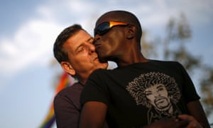 Michael Lafayette kisses his husband David Beck at a celebration rally in West Hollywood, California