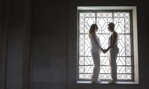 Stacy Wood and her wife, Michele Barr, pause between wedding photos at San Francisco's city hall