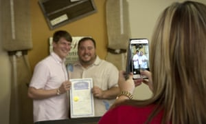 Sheila Sinyard, with the Miller County clerk's office, takes a photo of Alex Jones and Mark Porter in Texarkana, Arkansas