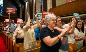 A crowd stands to applaud the decision at the Central Presbyterian Church in Austin, Texas