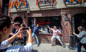 People celebrate at the historic Stonewall Inn in New York