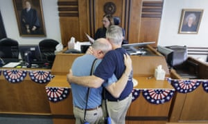 Gerald Gafford comforts his partner of 28 years, Jeff Sralla as they stand before Judge Amy Clark Meachum having obtained a license allowing them to get married this weekend in Austin, Texas