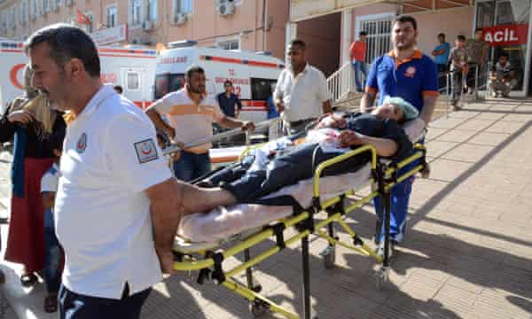 A man from Kobani wounded in Isis attacks is taken for treatment in Suruc on the Turkish side of the border.