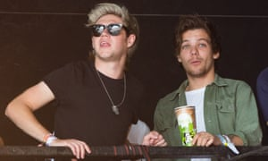 Genuine young people: Niall Horan, left, and Louis Tomlinson of One Direction watch James Bay at Glastonbury on Friday.