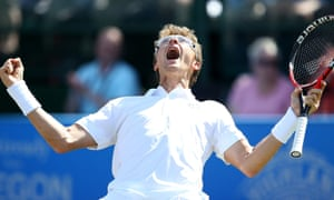 Denis Istomin of Uzbekistan celebrates his victory over the American Sam Querrey in the final of the Nottingham Open.