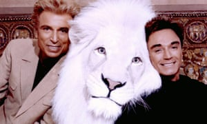 Siegfried and Roy pose with Pride, another white lion, in an undated photo.