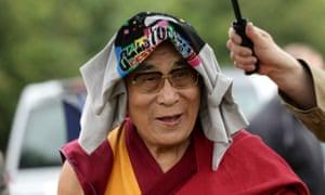 The Dalai Lama arrives at Glastonbury festival.