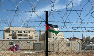 Palestinian flag on a barbed wire fence outside the Israeli settlement of Beitar Illit