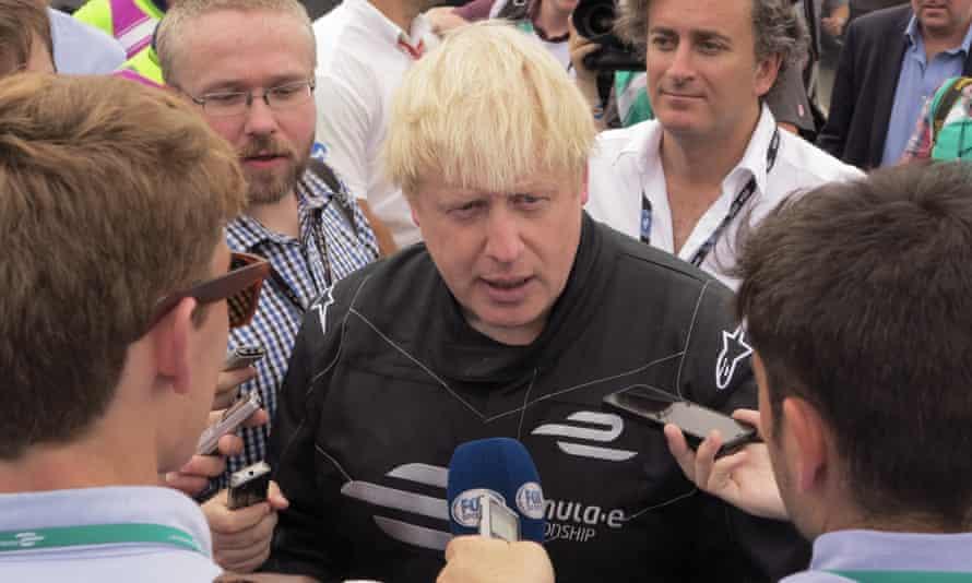 Boris Johnson tries out a Formula E race car at Battersea Park