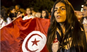 Local people stage an anti-terror protest in Sousse on 27 June 2015