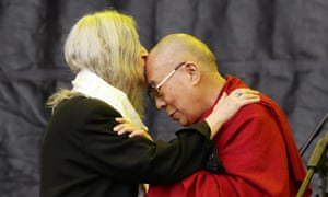 Patti Smith kisses the Dalai Lama during the Glastonbury festival.