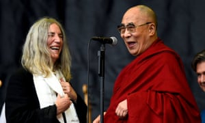 Patti Smith with the Dalai Lama on the Pyramid stage.