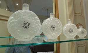 Going for a song: a set of four Lalique France Dahlia crystal perfume bottles.