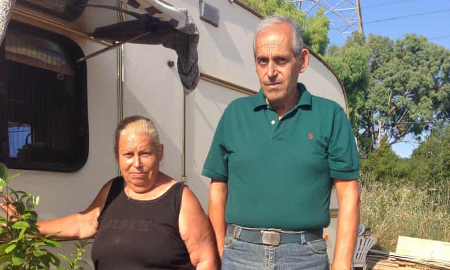 Georgios Karvouniaris and his sister Barbara outside their donated caravan, without which they would be homeless